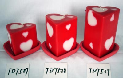Scented pillar candle in heart shape